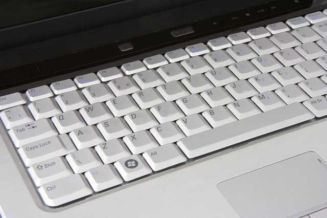 Silver laptop computer.